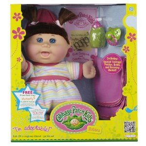 "Cabbage Patch Babies Doll - Caucasian Girl, Brunette Hair by Cabbage Patch Kids. $29.99. Ages 2 years and up. 12.5"" Baby in removeable fashion, playable hairdo, special cabbage leaf shaped bottle and pacifier and matching blanket. Comes with birth certificate and adoption papers. From the Manufacturer                Cabbage Patch Babies are back and the same as you remember them – adorable, soft, loveable and ready to be adopted and cared for. Each Cabbage Patch Baby comes w..."