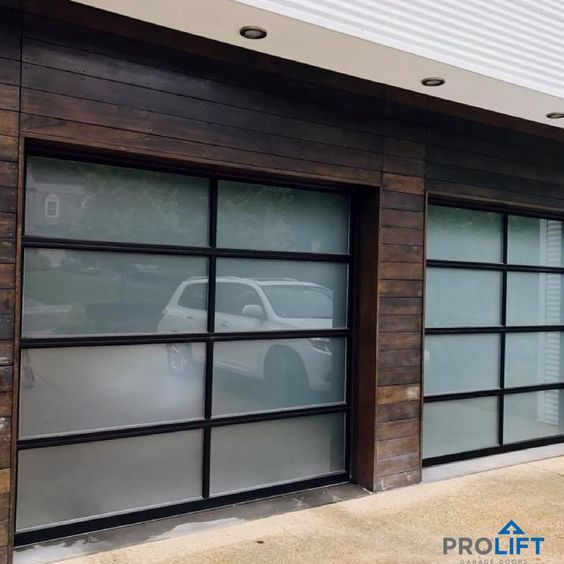 With a mid century modern vibe, these glass garage doors are an ideal fit for the home's style. Notice how the glass panels are tinted and framed in black aluminum. | Pro-Lift Garage Doors on Houzz | Photo Credits: Pro-Lift Garage Doors Va |