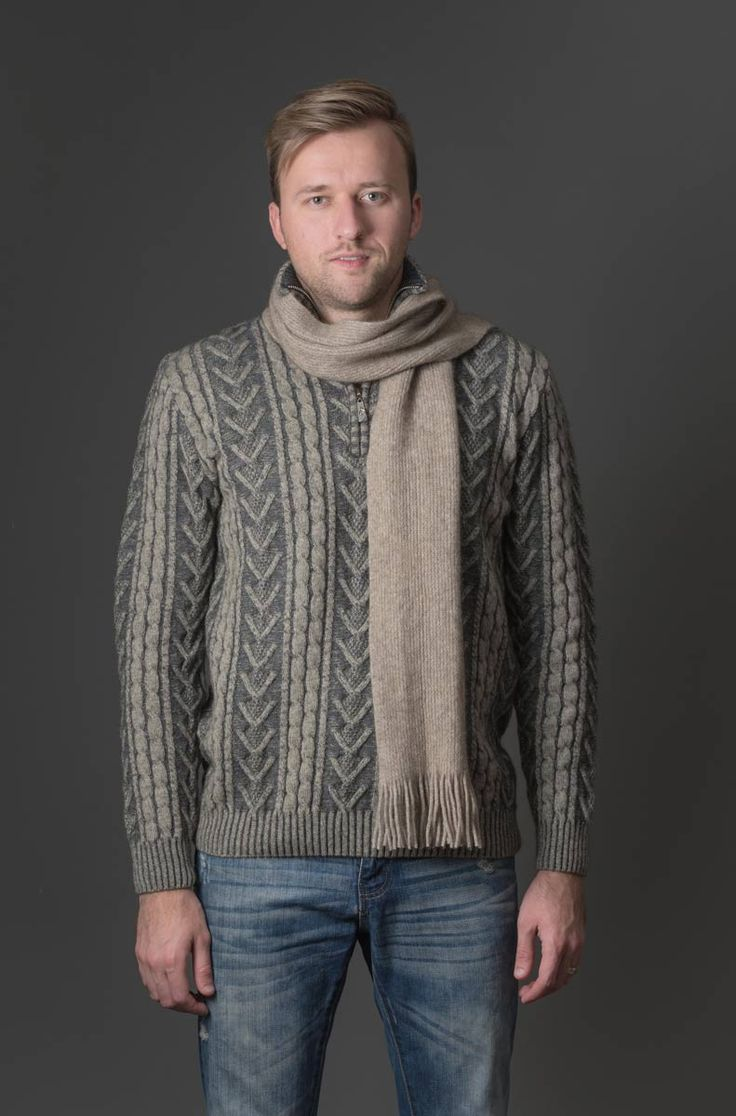 This is a great mens jumper with a heavy plated Aran texture and a half zip so you can regulate your body temperature and vent a bit of extra heat away. Available in two colours.The texture of the wool over the whole garment is a chunky two tone texture. If you are looking for a jumper that is a little bit different then this is it. Knitwear made in New Zealand.