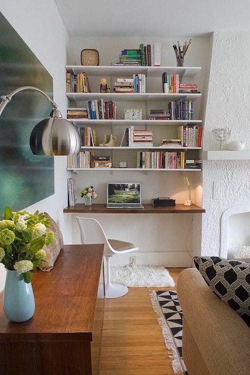 DIY Built In Bookshelves on a Budget | Find out how to hack or recreate these covet-worthy architectural details like a DIY built in of several IKEA BILLY bookcases.