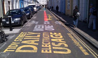 Tidy Street Project in England - measuring electricity usage and displayed on the street in chalk
