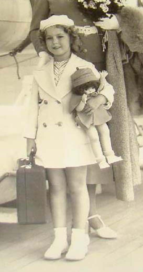 Shirley Temple with her Effanbee doll aboard The Mariposa on her way to Hawaii for the first time. (1935)
