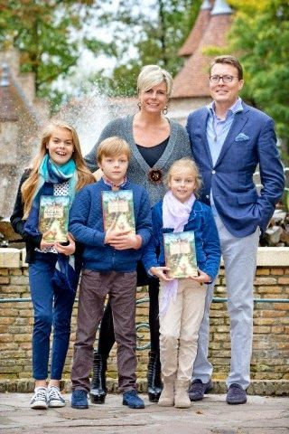Princess Laurentien presents fairy tail book in Kaatsheuvel. Here with her husband Prince Constantijn of The Netherlands and their children