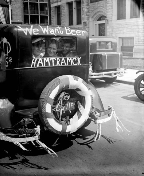 """1) And here they are again riding inside a car decorated with crepe paper and the message """"We Want Beer - Hamtramck"""" through Detroit in support of the repeal of Prohibition during the """"Beer Parade."""""""