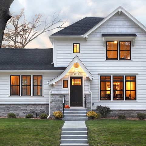 White siding black windows white trim grey stone for Black stone house