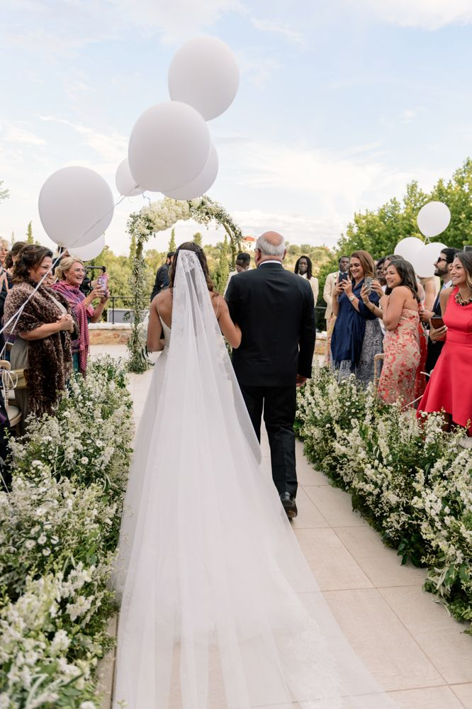 White balloons line the ceremony aisle