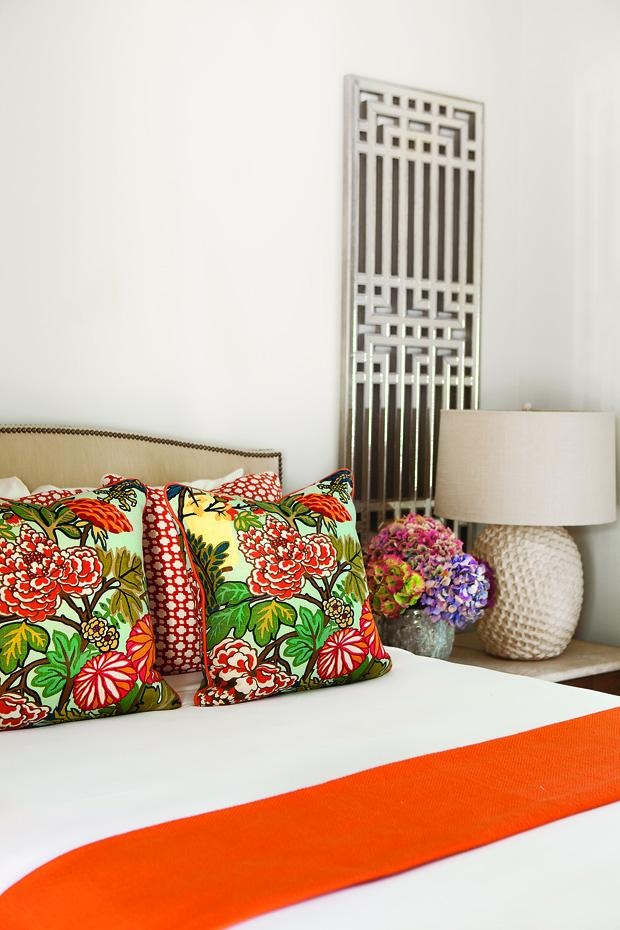 Bedroom - Orange floral pillows in the bedroom for a touch of fresh.