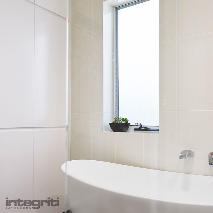 There's not much that compares to a nice relaxing bath by a window with some sunlight. Never forget your bathroom windows when planning a renovation. It can make all the difference in how your finished bathroom ends up looking and feeling. #integritibathrooms #custommade #sydneybathroom #interiordesign #bathroom #bath #bathtub #window #bathroomrenovation #bathroomremodel