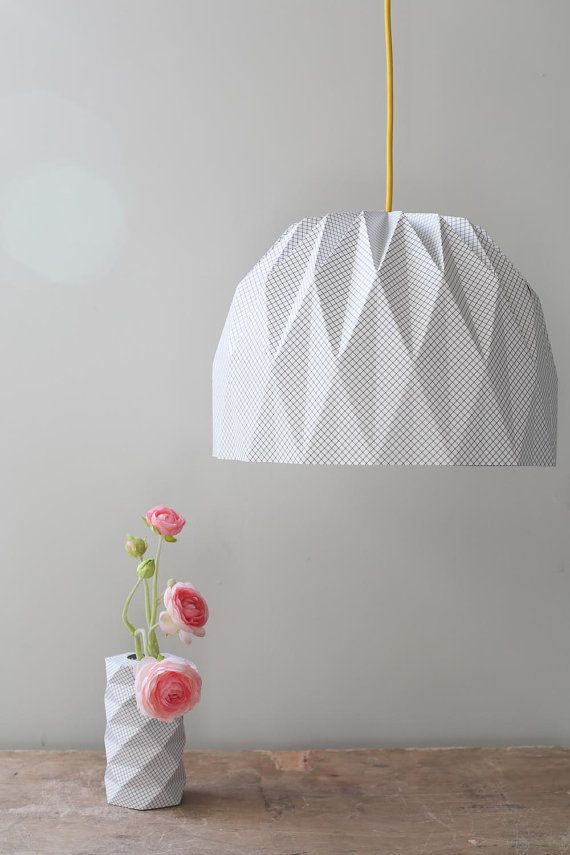 A beautiful origami pendent lampshade. Black and White plaid print on the out side, Black colored on the inside. The lampshade is two sided,