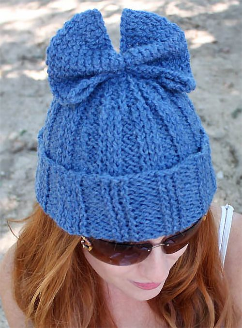 Free Knitting Pattern for Bow Hat - Gina Michele designed this easy wide ribbed beanie topped with a bow instead of a pompom. Sport yarn. Designed by Sybil R