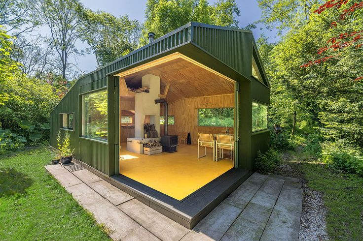 Camouflaged Thoreau cabin in the woods of Utrecht has no running water or electricity