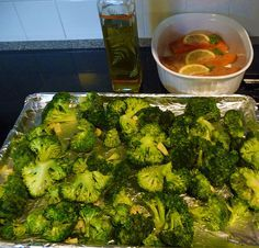 """~Best Broccoli Recipe Ever~ -You preheat the oven to 425. -Take 4 to 5 pounds of dry broccoli and put it on a foil covered baking sheet. -Toss with olive oil & salt and pepper. -Add 6 garlic cloves that are peeled and sliced and toss them in. Roast in the oven 20 to 25 minutes until """"crisp-tender and the tips of some of the florets are browned."""" squeeze a lemon all over the broccoli.-Add some more olive oil, -And 1/3 cup of freshly grated Parmesan cheese -Toss it all gently."""