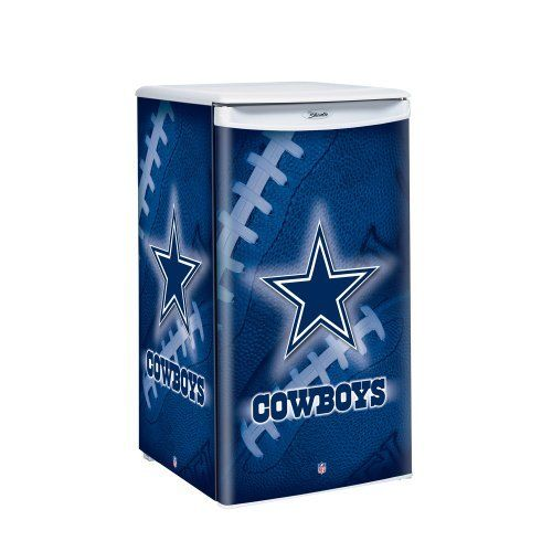 """NFL Dallas Cowboys Counter Top Refrigerator by Boelter Brands. $319.99. Features auto cycle, defrost, worktop, sliding shelves, and freezer. Officially licensed product. Holds up to 84 cans. Full wrap around team graphic with logo. Volume: 3.2 Cubit Feet; Width: 17"""", Depth: 19"""", Height: 32.5"""". From the Manufacturer                Keep your drinks cold and your snacks fresh with Boelter Brands Counter Height Fridge.  Fridge is 3.2 Cubic feet and measures 17"""" in width, 19"""" in de..."""