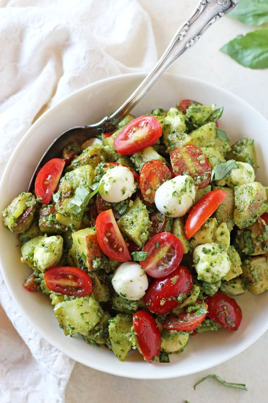 Fresh and fun, this caprese pesto potato salad is perfect for summer BBQs and picnics! Filled with yukon potatoes, kale pesto and no mayo in sight!