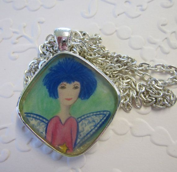 Angel Pendant with silver finish and silver look chain made from original art work and resin.