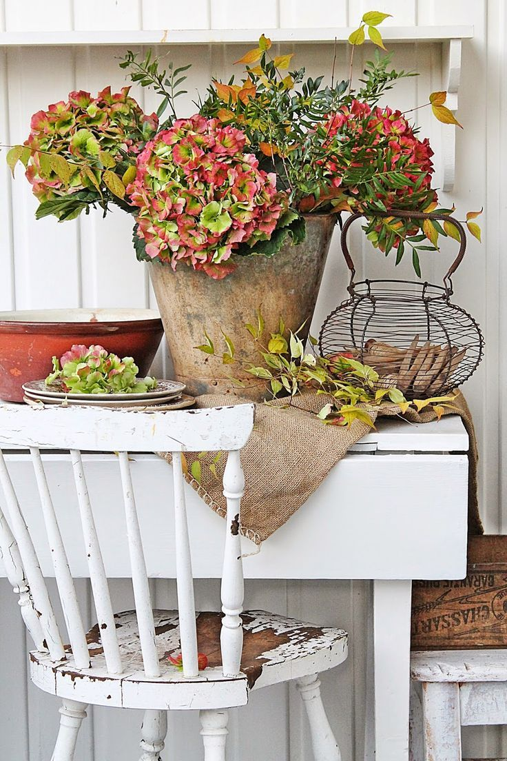 hydrangeas, an old bowl and a wire basket