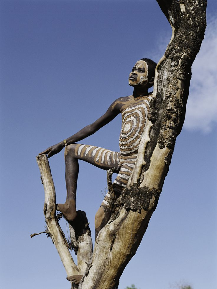 """A young boy climbing on a tree - Surma - """"It is imperfection - not perfection - that is the end result of the program written into that formidably complex engine that is the human brain, and of the influences exerted upon us by the environment and whoever takes care of us during the long years of our physical, psychological and intellectual development."""" Rita Levi-Montalcini, awarded the 1986 Nobel Prize in Physiology or Medicine , born on April 22th."""
