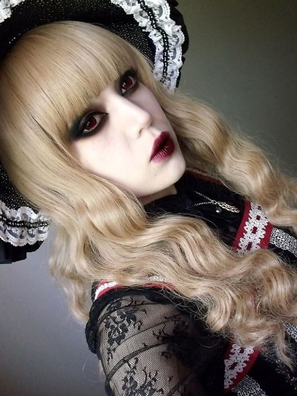 I like the blood red eyes and lips, gothic lolita