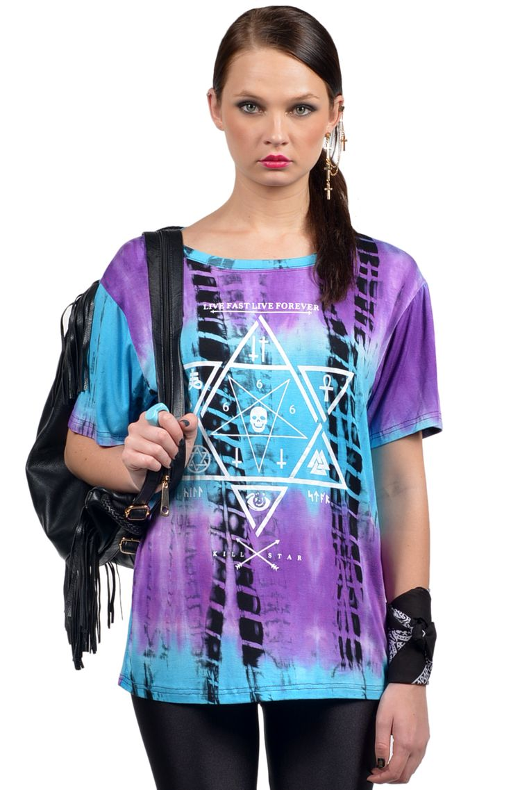 Super cool oversized ladies t-shirt in purple, turquoise and black tie dye with white symbolic print. Rad worn with leggings, lace up jelly boots, leather backpack and bandanna. Length: 64cm. Width: 46cm.