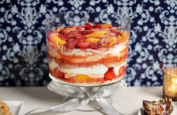 """Summer Fruit Trifle made with strawberries, peaches, and amazing lemon cream instead of custard. To quote the recipe....""""it will knock you naked."""" I am making it for sure then if that's what happens!!!!"""