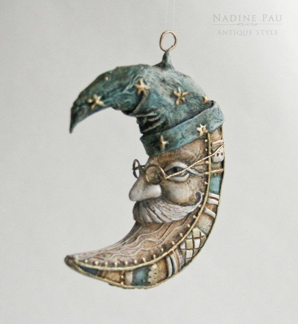 """Crescent"" by Nadine Pau. Christmas ornaments. Papier mache, oil patina varnish. Sold #christmasornaments #nadinepau"