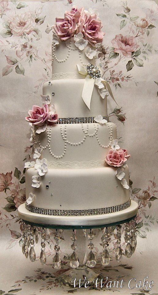 Beautiful 4 tiered round white and pink cake. OMG this cake is wonderfully Beautiful.