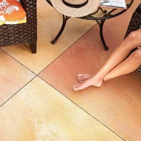 DIY:  How to Add Character to a Plain Concrete Patio - kerfs were cut into the concrete creating the look of individual stone slabs, then sprayed with stain.  For less than $100, you can give an existing patio a totally new look - via Family Handyman