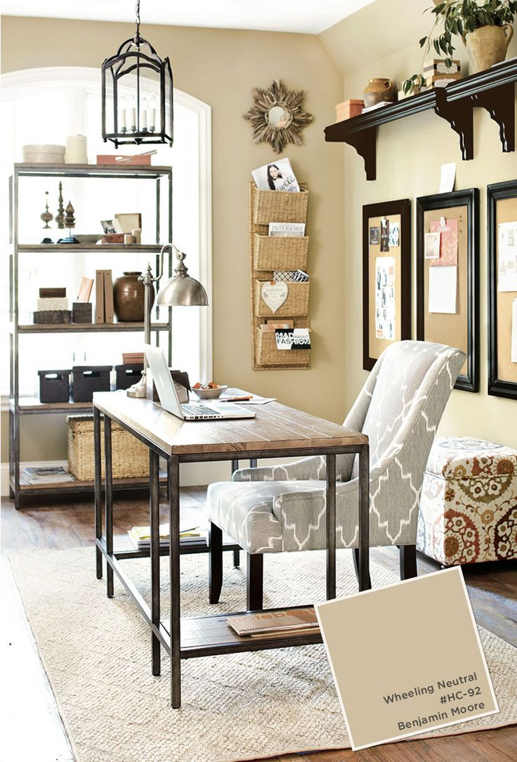office area in living room. home office with ballard designs furnishings. benjamin moore wheeling neutral paint color. area in living room