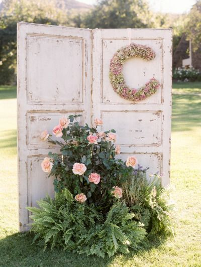 Rustic old door and roses wedding decor