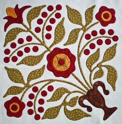 Tutorial on machine applique that looks like it's been done by hand. I substituted water soluble fusible stabilizer.
