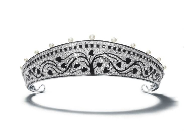 Tiara, Cartier Paris, 1914 Produced by Cartier Paris in 1914, this audacious avant-garde piece is a magnificent example of the Art Deco styl...