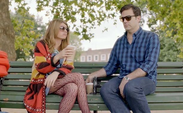 Sharon from Catastrophe. Denim dress, purple lace tights, oversized sweater, sunglasses
