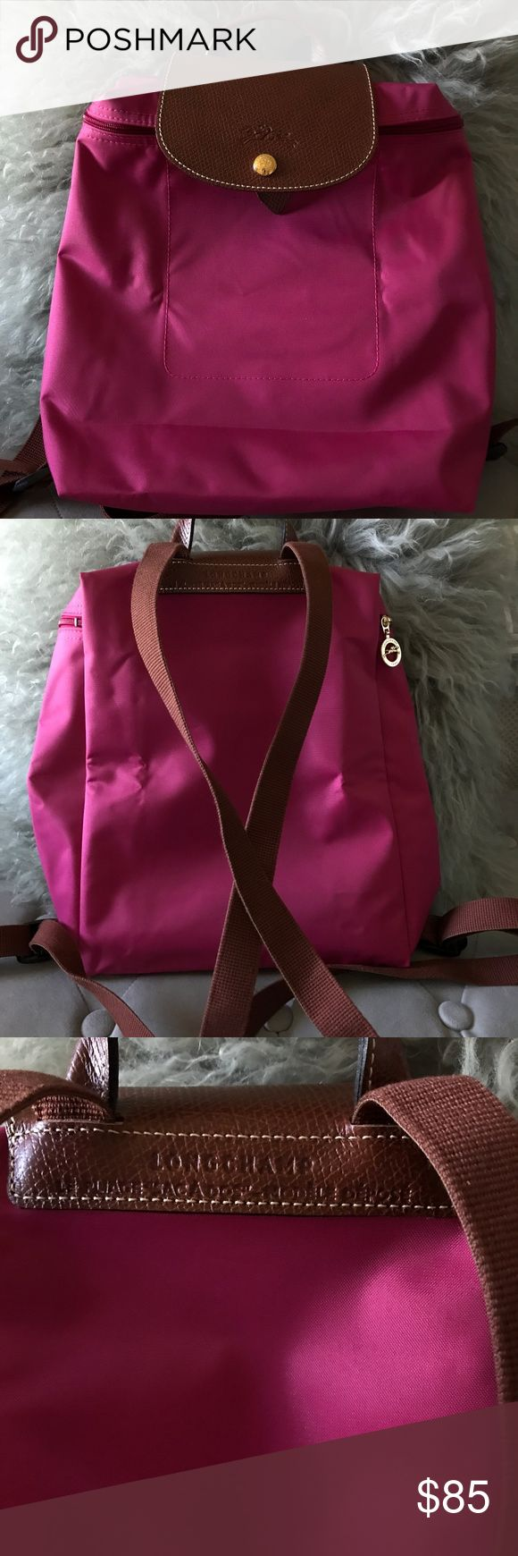 """Longchamp Le Pliage Zippered Backpack """"Pink"""" Like new, excellent condition.  Only used once. Have tags.  Color is """"Pink"""" from Fall 2016.   This backpack with a snap-fastening button flap plays with all the codes of the Le Pliage bag, the emblematic Longchamp model.  LE PLIAGE is light as a feather, folds away to the size of a paperback, and is durable enough to keep all your essentials close at hand. Longchamp Bags Backpacks"""