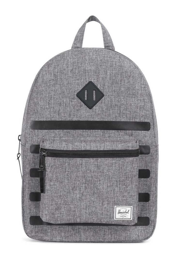 """Do you know your roots? The Heritage in Raven from Herschel Supply Co. certainly does. With a signature shape and feel this sleek backpack will help define your style for years to come. Spacious main compartment can hold books clothes or other daily essentials. Interior sleeve pocket can hold up to a 15"""" laptop. Additional front compartment with a key clip. Internal media pocket for added storage options. Leather diamond detail accents the front of bag. Herschel Suppler Co. tag in bottom…"""