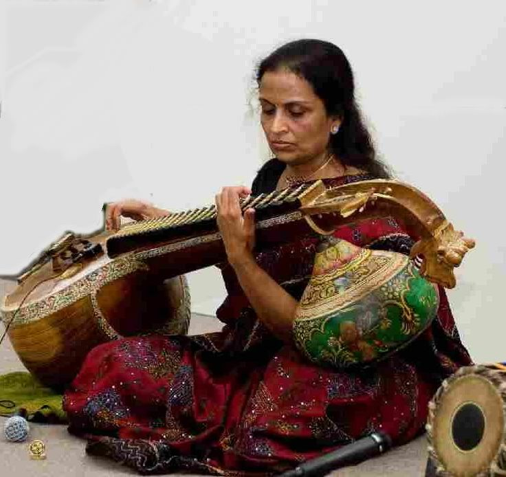 """South Indian veena master Durga Krishnan is a disciple of the legendary virtuoso, the late Dr. Chittibabu, whom she has accompanied in performance and on recordings, and is currently a student of Padmabhushan Sri Lalgudi G. Jayaraman, one of the greatest figures in contemporary Carnatic tradition. She holds the degree """"Sangeetha Vidwan"""" (Scholar of Music) and is a certified teacher of Carnatic Music."""