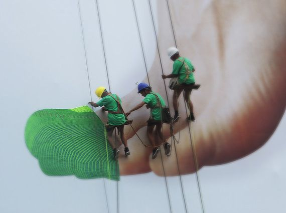 """To promote its latest 'Free Flyknit' shoes in Shanghai, Nike put together a live 'knitting session' on a giant billboard. With the help of three workers, they 'knitted' strips of neon green thread together on the billboard to form a Free Flyknit shoe around a foot - emphasizing the sock-like quality of the shoes.   This live 'knitting session' took place in Nanjing East Road, one of the """"most heavily trafficked streets"""" in the Shanghai.  http://www.youtube.com/watch?v=NMb7Wjv6peE"""