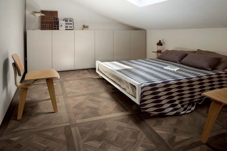 Bedroom with wood effect flooring: Wooden Tile of CDC. Interesting idea for laying floor tiles. #flooring #wooden #tiles #bedroom #ceramic #ideas #creative