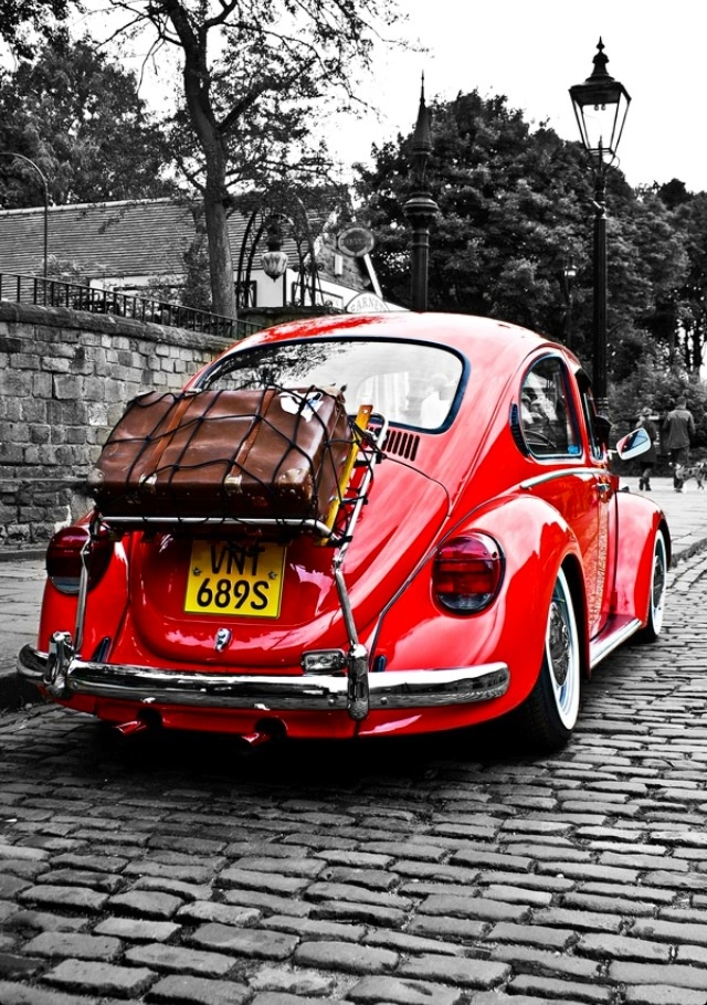 VW Beatle. Red like a ladybug, also a Beatle Mobile