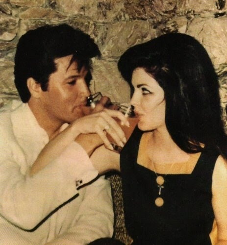 Fave style icon: Priscilla Presley-Fair skin, big black hair and major cat eye. Plus, Elvis as an accessory.