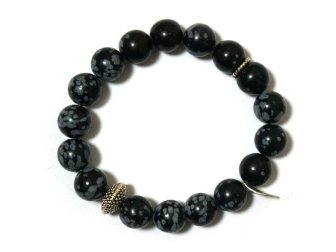 Black Fossil strech bracelet with metal charm