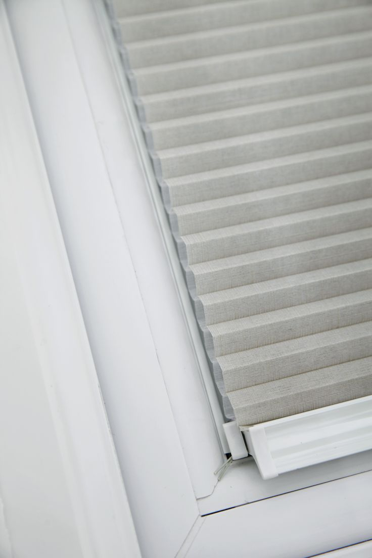 Taupe Intu pleated blinds by Apollo Blinds.