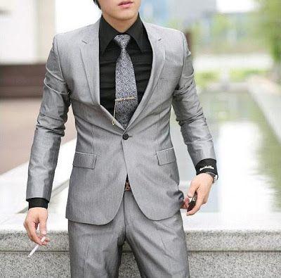 combinar traje-moda hombre-gq-tendencia hombre-tendenciagq-combinar traje gris con camisa negra
