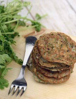 Here is a delicious, tummy-friendly pancake made of grated potatoes and bajra flour, perked up with onions, coriander and other lovely ingredients. Interestingly, this combination of ingredients also works against the tummy acids, keeping them under control.