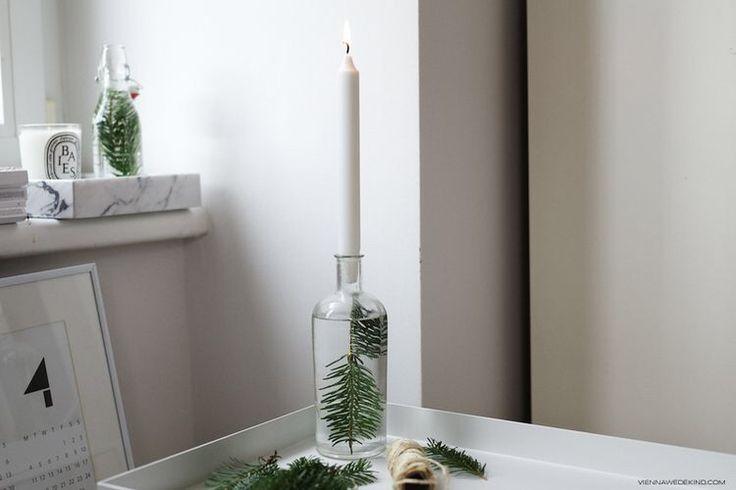 """""""En liten grankvist, en flaska i klarglas, kranvatten, ett vitt ljus och en kniv att forma ljuset med och vips har du julens finaste ljusstake."""""""