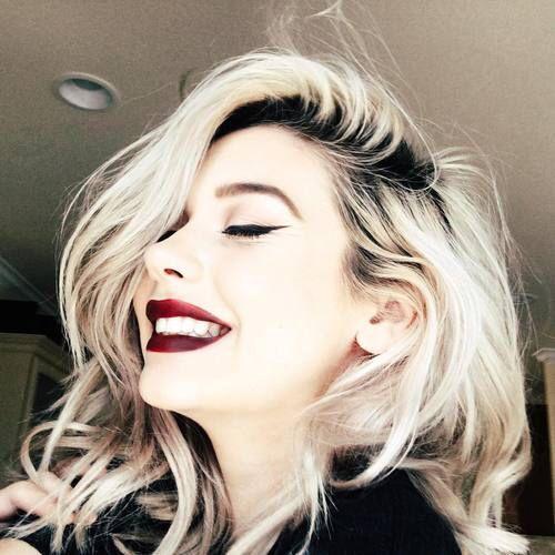 Platinum blonde hair, blonde hair color, dark roots, makeup, red lipstick, eyeliner                                                                                                                                                      More