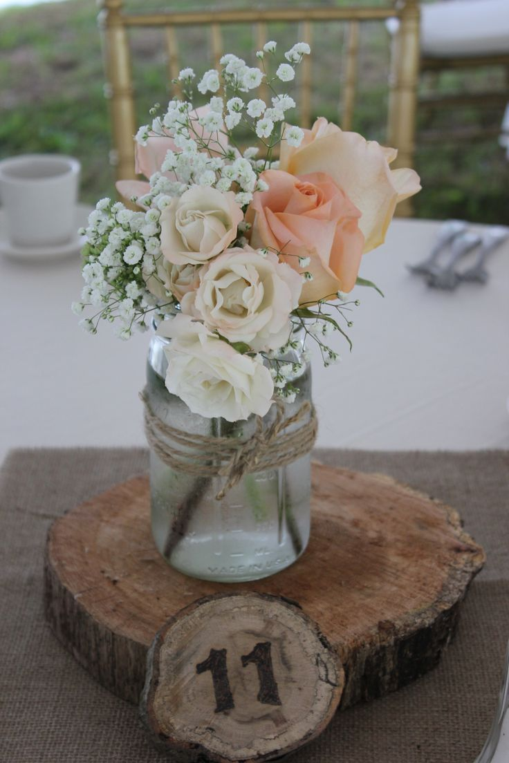 Tiffany peach roses, majolica spray roses and babies breath in a  mason jar for a lovely summertime wedding.