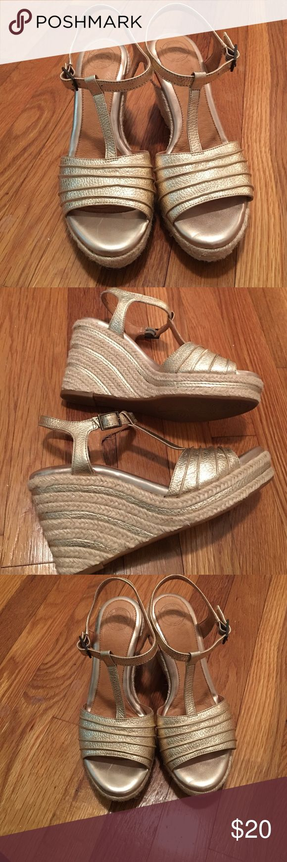 Metallic wedges Champagne metallic espadrille wedges with t-strap design. Cushioned insole. These have never been worn. Shoes Wedges