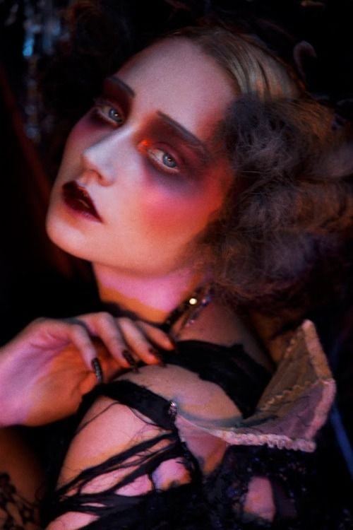 I love the makeup in this shot. A glamorous zombie look.