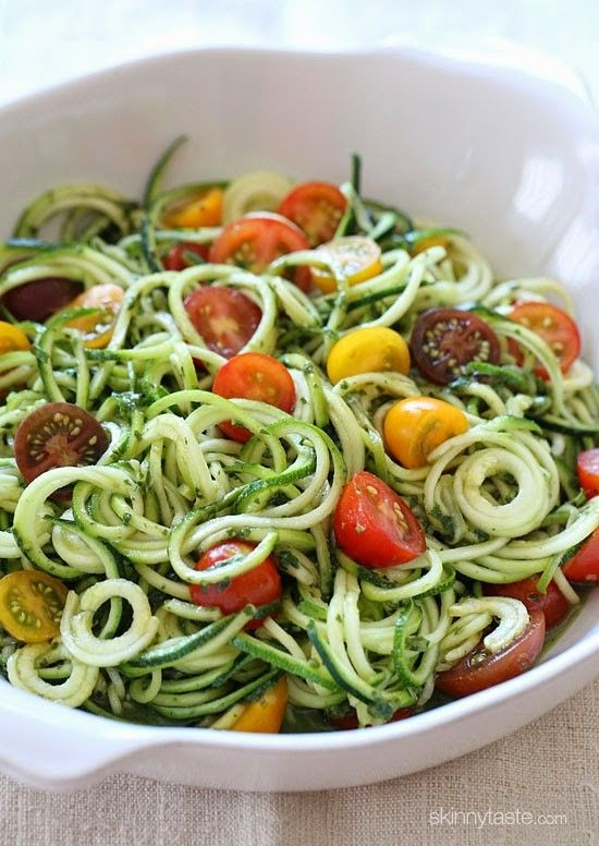 I combined all of my favorite end-of-summer garden vegetables and created this simple, raw, vegetarian spiralized zucchini and pesto dish.  As much as I look forward to the Fall, I'm not quite ready for summer to be over. Having fresh herbs at my fingertips is what I'll miss the most, so I'm taking all my basil and making skinny pesto with it to freeze and use throughout the year.     I'm also going to miss eating zucchini 4 days a week, especially in a zoodle form... although I'm not…
