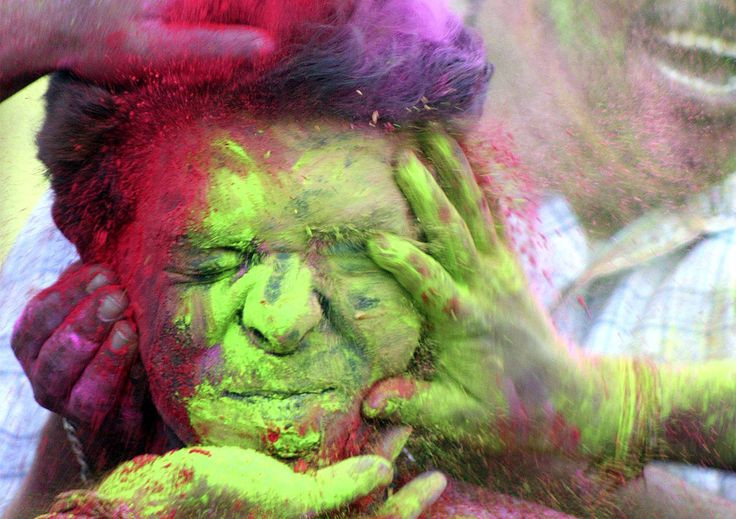 A boy reacts as his face is smeared with colored powder by many others during Holi, in Calcutta, India, Wednesday March 11, 2009. (AP Photo/Sucheta Das)